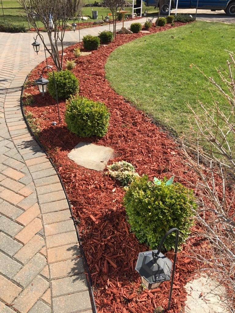 A little bit of mulch will spruce up your yard""
